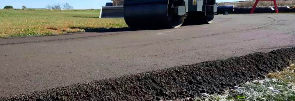 Rolling a tarmac road