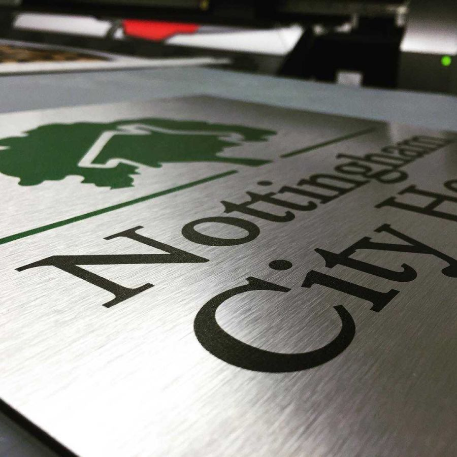 Brushed stainless steel sign for Nottingham City Homes