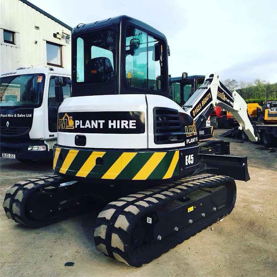 Tracked digger with branding and contact details