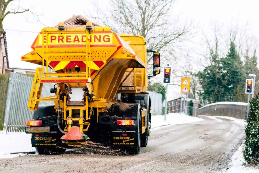 Road gritter in action showing some True Grit